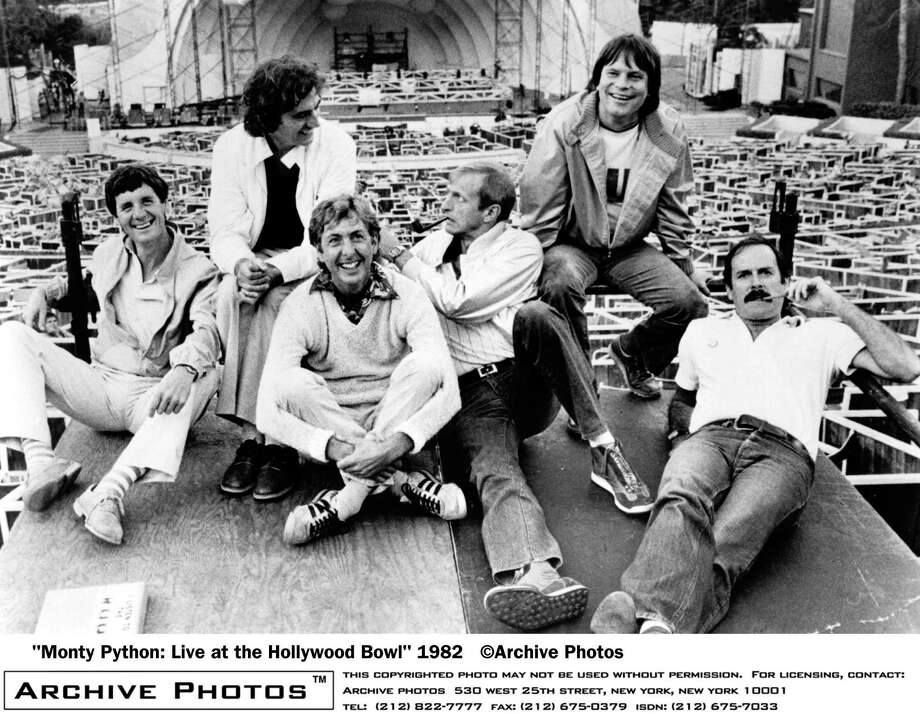 Monty Python does LaLa land. Michael Palin, Terry Jones, Eric Idle, Graham Chapman, Terry Gilliam, and John Cleese, lounge about at the site of their filmed live show at the Hollywood Bowl in 1982. Chapman and Cleese smoke pipes. Photo: Hulton Archive, Getty / 2004 Getty Images