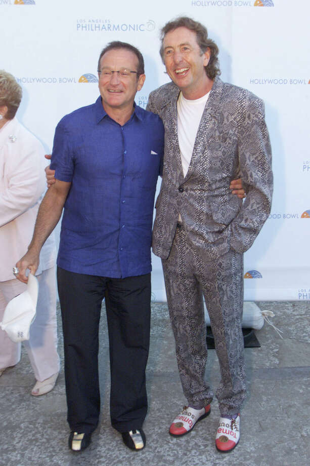 Birds of a feather do flock together. Robin Williams helped induct Eric Idle, representing 'Monty Python', into the Hollywood Bowl Hall of Fame at the opening night gala and concert celebrating the Bowl's 80th season in Los Angeles pm June 29, 2001 Photo by Kevin Winter/Getty Images Photo: Kevin Winter, Getty / Getty Images North America
