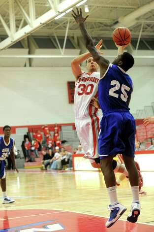 Sacred Heart University's Nick Greenbacker puts up a shot  as he is defended by Chris Baskerville during Thursday's game against Central Connecticut State University in Fairfield on January 13, 2011. Photo: Lindsay Niegelberg, ST / Connecticut Post