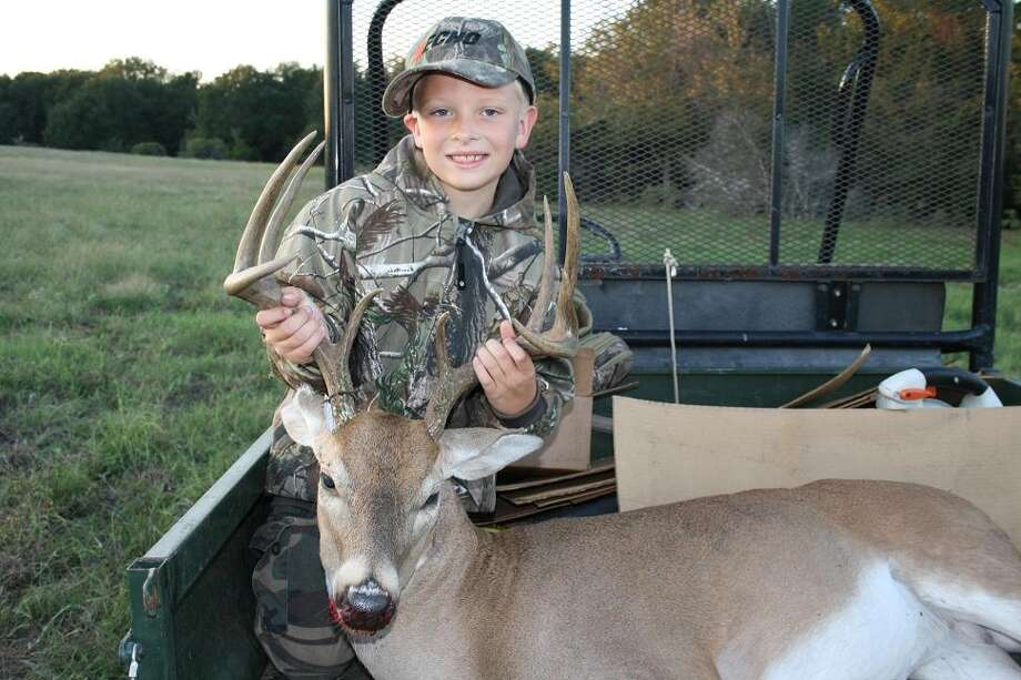 "Jonathan Klepetko, age 7, shot his first deer on Oct. 27 in Lexington, Texas. The state's youth-only deer hunting season was from Oct. 27-28 and from Jan. 7-20, 2013. Jonathan's mom, Crystal Klepetko, said the deer weighed about 160 pounds. ""He is ready to go hunting again,"" she said.  Photo: Submitted Photo"