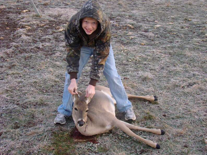 Derick Harrison of Tomball with his first deer at age 13.