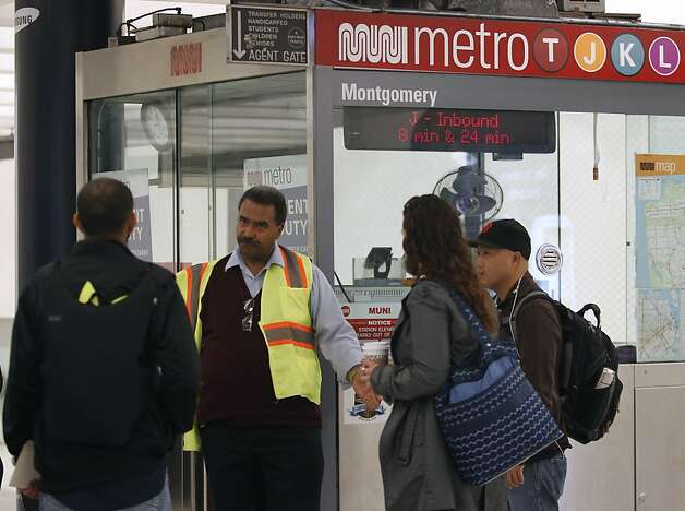 A Muni employee assists passengers after underground service was halted for several hours in San Francisco, Calif. on Friday, Nov. 2, 2012 when an unidentified man was struck and killed by a Metro streetcar between the Montgomery and Embarcadero stations. Photo: Paul Chinn, The Chronicle