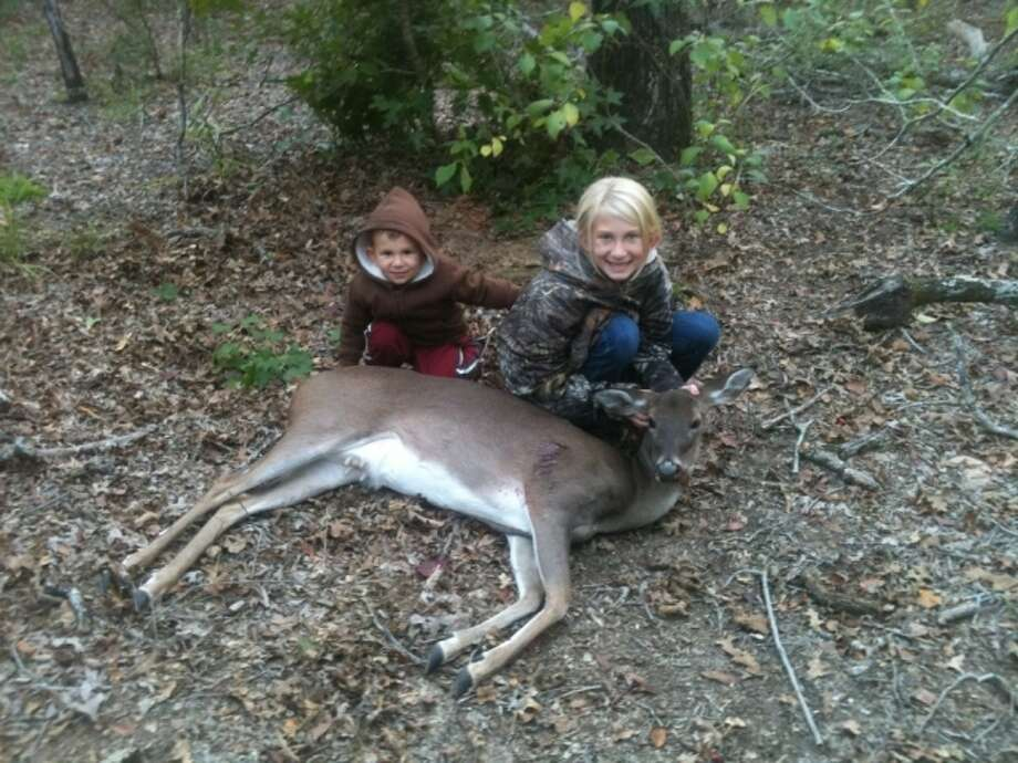 Sydney Kennedy, 11, and her little brother, Zane, 2, with a deer shot by Sydney during Texas' youth weekend Oct. 26-27. Photo: Submitted Photo