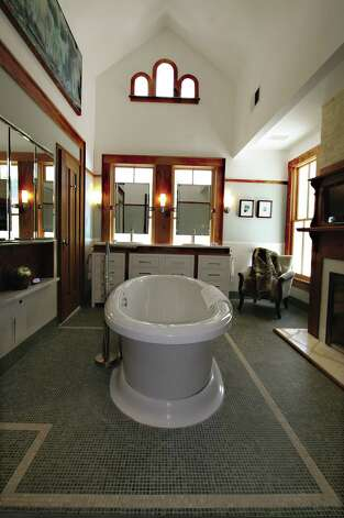 "A sleek, modern bath is a surprise in the Nix house, built in 1899 and restored in 2006 to achieve LEED Platinum certification. The house in King William is one of 26 featured in ""Old Places, New Spaces,"" a look at modernization of old houses in San Antonio. Photo:  From ""Old Places, New Spaces"" ("