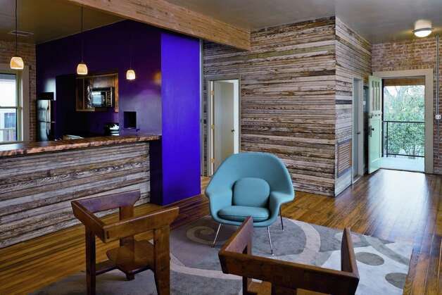 "Bold paint contrasts with salvaged beadboard and exposed brick in a repurposed grocery store in Southtown. Photo: From ""Old Places New Spaces"""