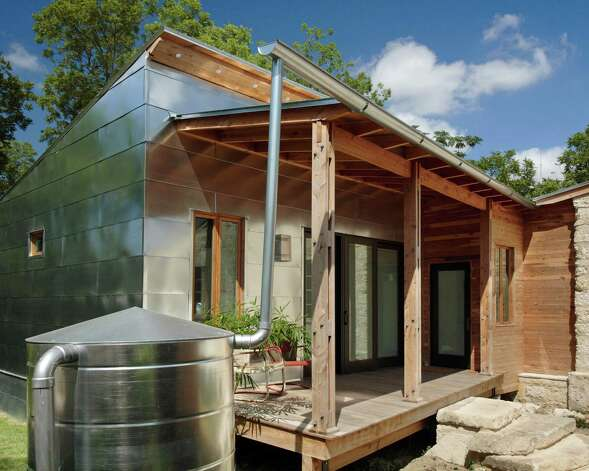 "Architect Candid Rogers chose Texas vernacular materials such as galvanized metal and cedar siding for an addition to a tiny caliche cottage in Lavaca.   The project is featured in ""Old Places, New Spaces."" Photo:  From ""Old Places, New Spaces"" ("