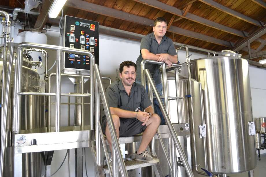 Ryan Soroka, left, and brewer Aaron Corsi of 8th Wonder Brewing Co. in EaDo. The brewers won't fire up this 20-barrel brewhouse until they get their final city permits. Once that happens, the beers should be available four to five weeks later. (Ronnie Crocker / Beer, TX)