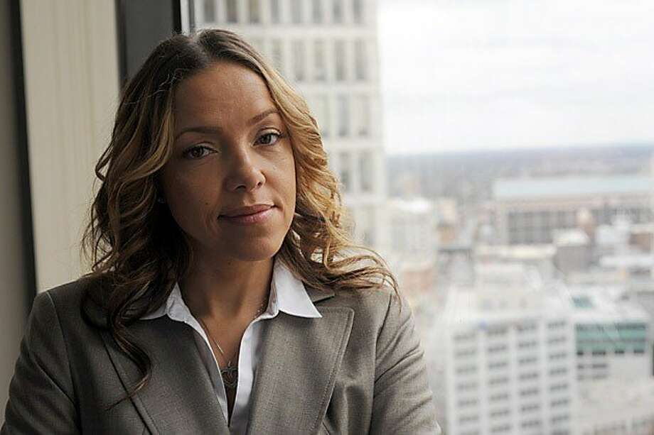 Serena Nunn at her office in Atlanta in 2011. As a 19-year-old, Nunn was convicted of a drug crime. Her mandatory 15-year sentence was commuted by President Clinton. Now 42, she is asking President Obama for a pardon so she can practice law. (Erik S. Lesser for ProPublica) Photo: Erik S. Lesser, ProPublica