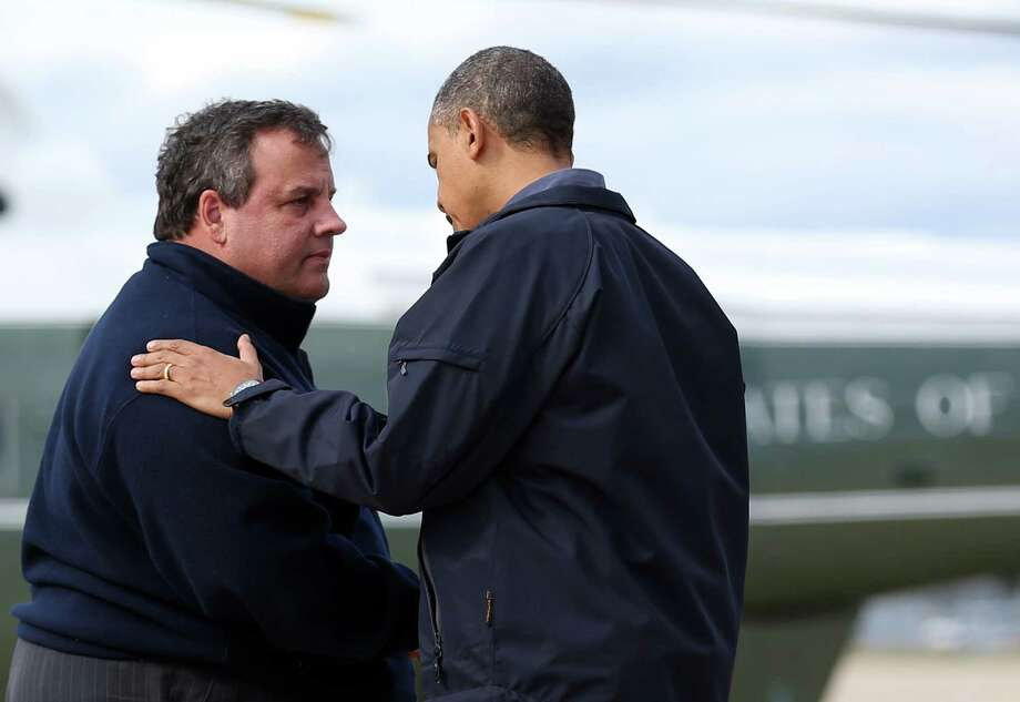 President Barack Obama is greeted by New Jersey Gov. Chris Christie upon arrival to the airport in Atlantic City, N.J., Oct. 31, 2012. Obama and Christie were to view damage left by Hurricane Sandy later Wednesday. (Doug Mills/The New York Times) Photo: NYT, STF / NYTNS