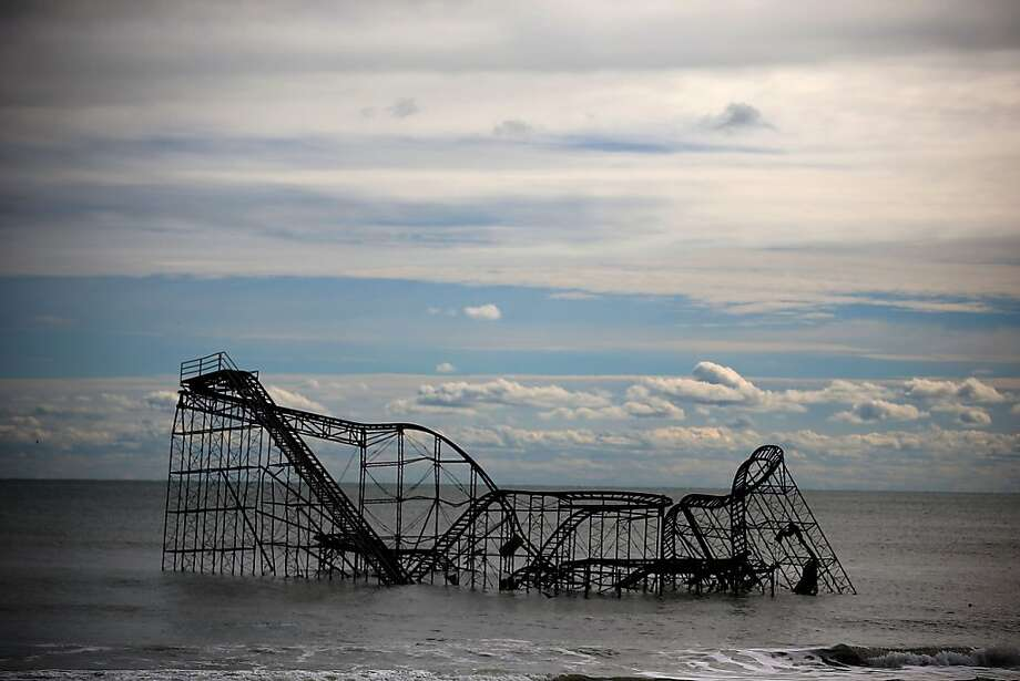 Sad times for Fun Town:A roller coaster sits in the Atlantic Ocean after the Fun Town pier it sat on was destroyed by Superstorm Sandy in Seaside Heights, N.J. Photo: Mark Wilson, Getty Images