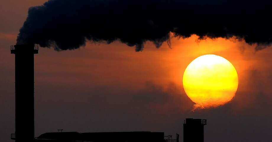 Polluted sky: A chimney spews smoke and unknown toxins at sunset in Wismar, Germany. Photo: Daniel Reinhardt, AFP/Getty Images