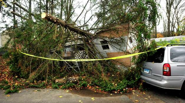 This is Kathleen Wade's crushed mobile home after two trees fell on it during Hurricane Sandy in Newtown. Photographed Friday, Nov. 2, 2012. Photo: Michael Duffy / The News-Times