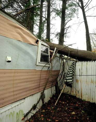 This is Kathleen Wade's crushed mobile home after two trees fell on it during Hurricane Sandy in Newtown. Photographed Friday, Nov. 2, 2012. Photo: Michael Duffy