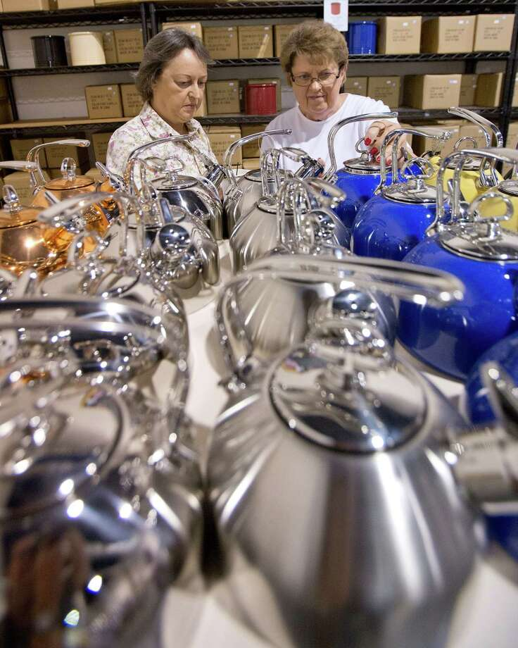 11/2/12: Left to right; Jane Tannous from Jersey Village and her sister Becky Shaieb , from Oklahoma look at classic teakettle enamel on steel at the Chantal warehouse located at 5452 N. Sam Houston Parkway West Houston, Texas. The warehouse opens the doors the first three weekends of November where customers can save 50- 75 % off retail. Photo: Thomas B. Shea / © 2012 Thomas B. Shea