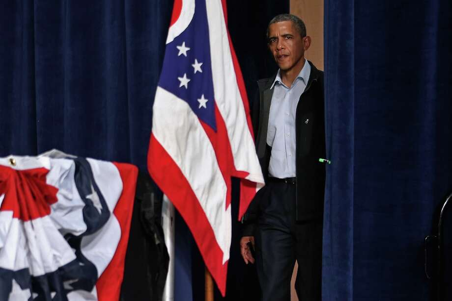 SPRINGFIELD, OH - NOVEMBER 02:  U.S. President Barack Obama walks from backstage during a campaign rally at Springfield High School November 2, 2012 in Springfield, Ohio. With four days left until the general election, Obama and the Republican presidential nominee, former Massachusetts Gov. Mitt Romney, are racing from swing-state to swing-state in an attempt to change voters' minds at the last minute.  (Photo by Chip Somodevilla/Getty Images) Photo: Chip Somodevilla, Getty Images / 2012 Getty Images
