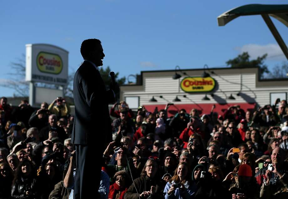 WEST ALLIS, WI - NOVEMBER 02:  Republican presidential candidate, former Massachusetts Gov. Mitt Romney  speaks to an overflow crowd during a campaign rally at the Wisconsin Products Pavilion at State Fair Park on November 2, 2012 in West Allis, Wisconsin. With less than one week to go before election day, Mitt Romney is campaigning in Wisconsin and Ohio.  (Photo by Justin Sullivan/Getty Images) Photo: Justin Sullivan, Getty Images / 2012 Getty Images