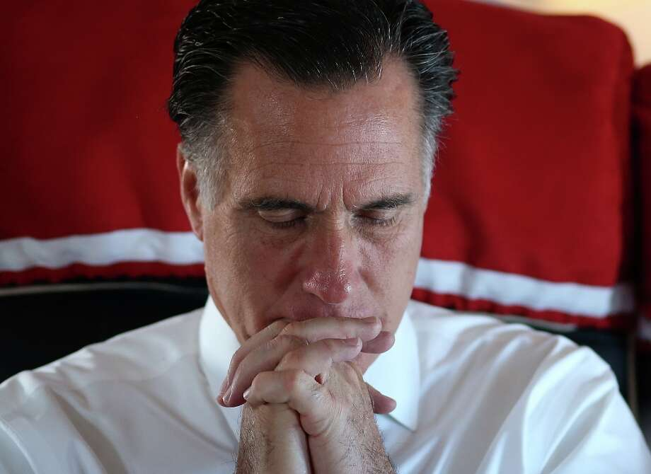 IN FLIGHT - NOVEMBER 02:  Republican presidential candidate, former Massachusetts Gov. Mitt Romney sits aboard his campaign plane on November 2, 2012 en route to Milwaukee, Wisconsin. With less than one week to go before election day, Mitt Romney is campaigning in Wisconsin and Ohio.  (Photo by Justin Sullivan/Getty Images) Photo: Justin Sullivan, Getty Images / 2012 Getty Images