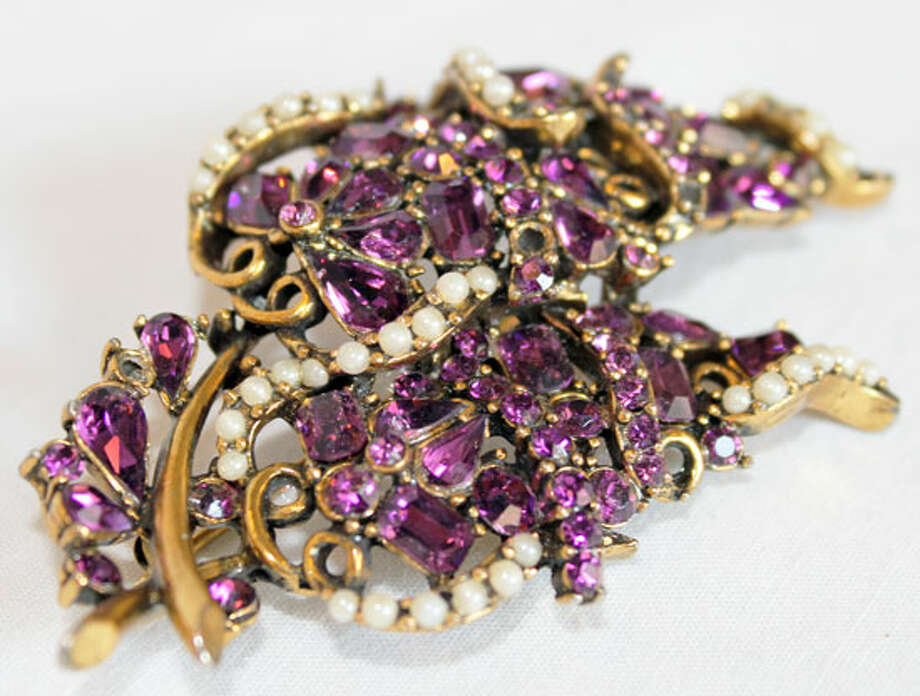 Vintage Hollycraft brooch with purple rhinestones Photo: Lauren Robinson/Seattle Goodwill
