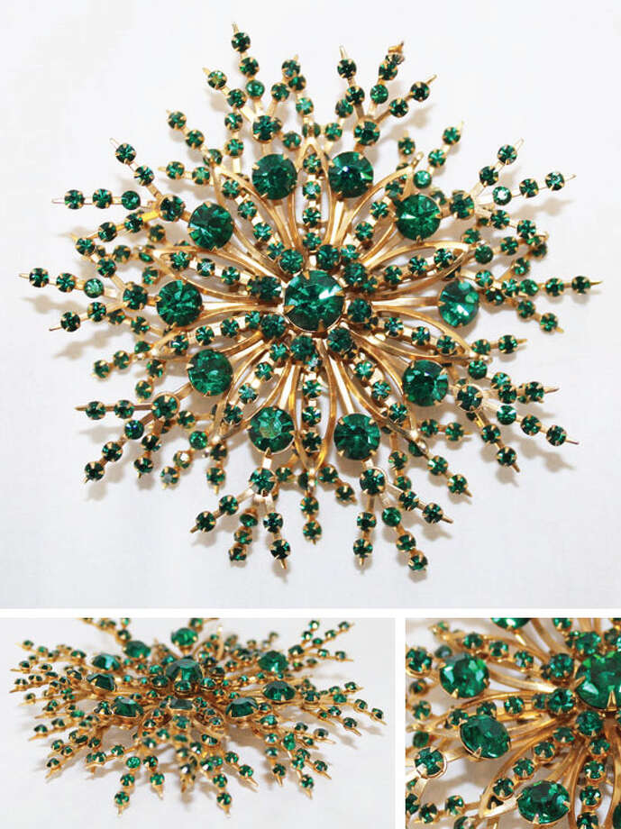 Vintage snowflake brooch with green rhinestones Photo: Lauren Robinson/Seattle Goodwill