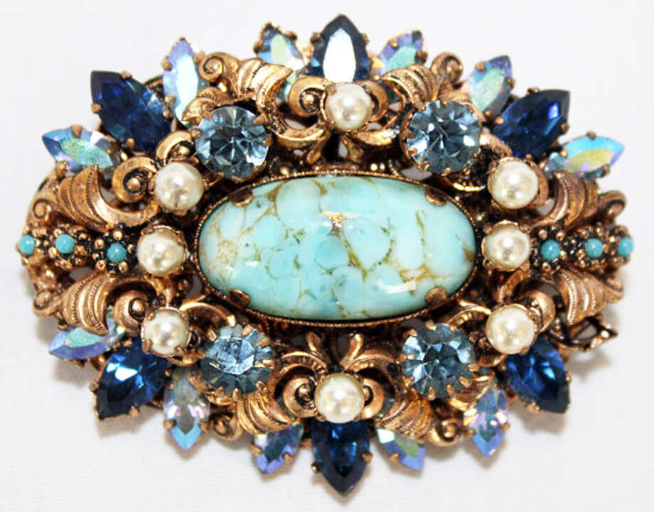 Brooch with filigree base, faux pearls and turquoise seed pearls Photo: Lauren Robinson/Seattle Goodwill