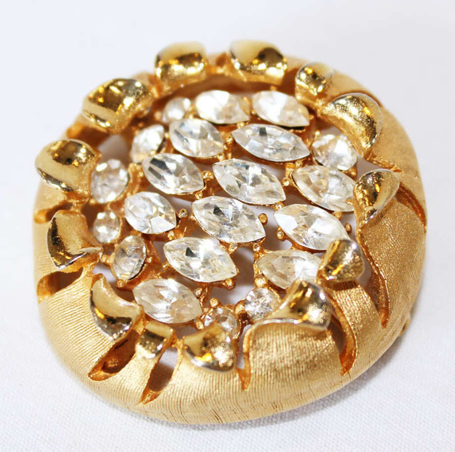 Gold brooch with a crystal center Photo: Lauren Robinson/Seattle Goodwill