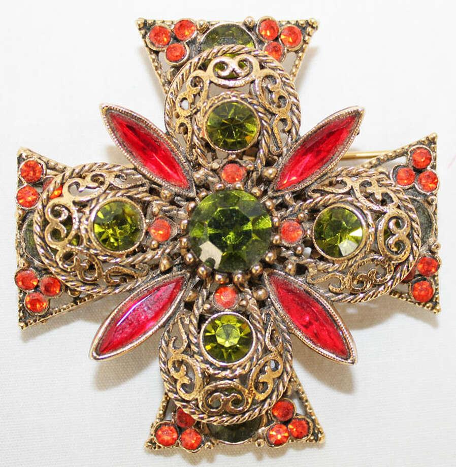 Emmons orange and green cross brooch Photo: Lauren Robinson/Seattle Goodwill