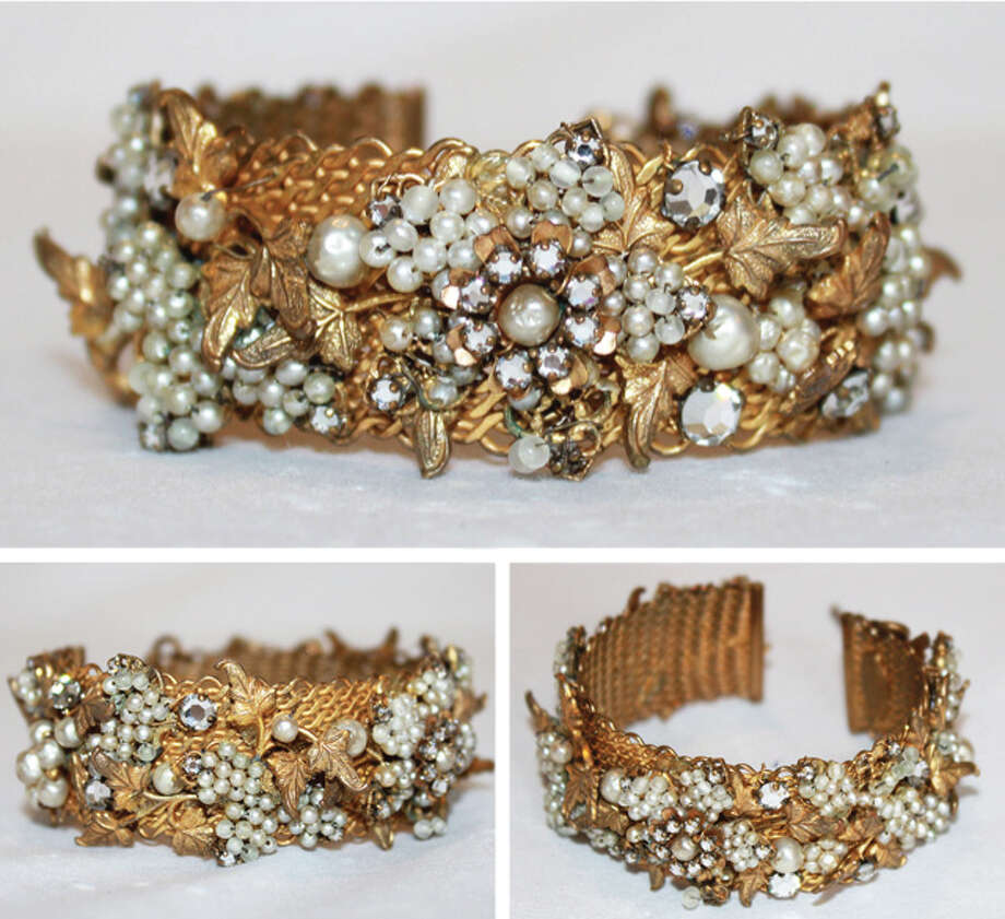 DeMario gold cuff bracelet Photo: Lauren Robinson/Seattle Goodwill