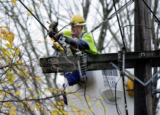 A CL&P lineman works on Route 35 in Ridgefield, Conn. where many of the residents were out of power due to Hurricane Sandy, Tuesday, Oct. 30, 2012. Photo: Carol Kaliff / The News-Times