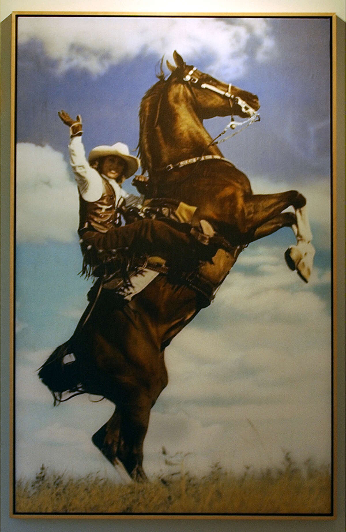 Julianna Holt shown in a photograph by Gray Hawn that hangs in the Holt office in San Antonio.