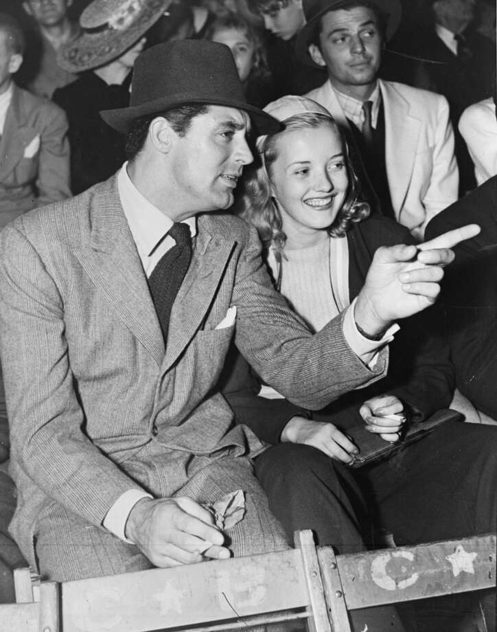 circa 1937:  Film star Cary Grant (Archibald Leach) (1904 - 1986) points out something of interest to film actress Phyllis Brooks (Phyllis Steiller) (1915 - 1995).  (Photo by General Photographic Agency/Getty Images) (Getty Images)