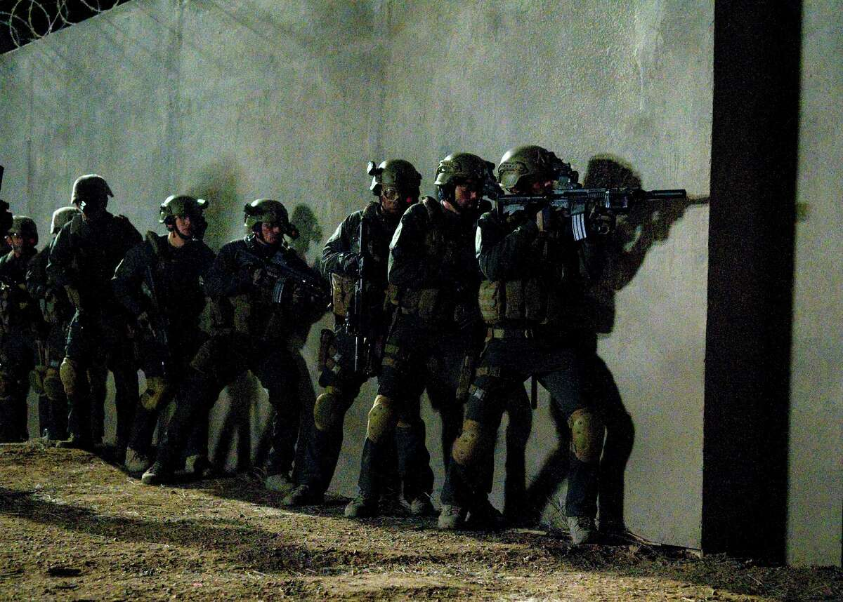 This film image released by National Geographic Channels shows actors portraying members of the SEAL Team Six soldiers who raided the compound of Osama Bin Laden in
