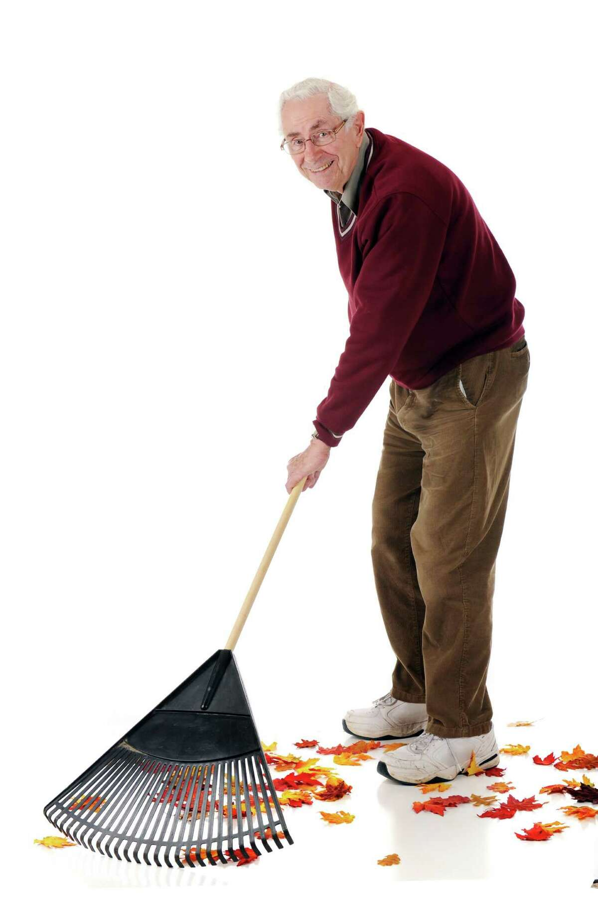 Make sure you use good form to avoid hurting yourself raking leaves. (Fotolia.com)