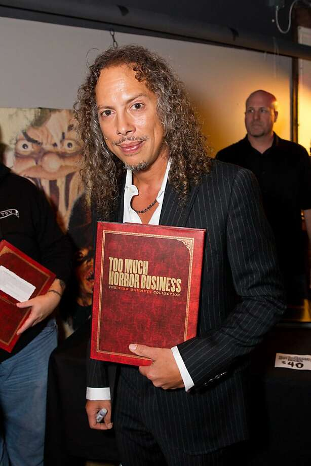 "Metallica guitarist Kirk Hammett may be the only rock star to have ever given an interview wearing fangs, and if so, there was a reason. The self-proclaimed horror nerd released his first book, ""Too Much Horror Business: The Kirk Hammett Collection,"" a 224-page coffee table tome co-written by Steffan Chirazi, containing pictures of 300 items in the guitarist's vast collection of vintage horror posters, masks, toys and other collectibles. He held a book launch and Day of the Dead party at Public Works nightclub in the Mission on Nov. 1, attended by hundreds of fans in playfully ghoulish attire. Since age 5, he has been a fan of creepy stuff because ""it was something I could relate to more than Disney movies,"" he said in a brief chat in the club's VIP room.  ""Horror is exciting and adventurous. It's a reffirmation of my existence, not to get too existential."" Would he count playing stadium concerts in front of 80,000 fans terrifying? ""No,"" he said with a laugh. ""That's easy."" Photo: Drew Altizer Photography"