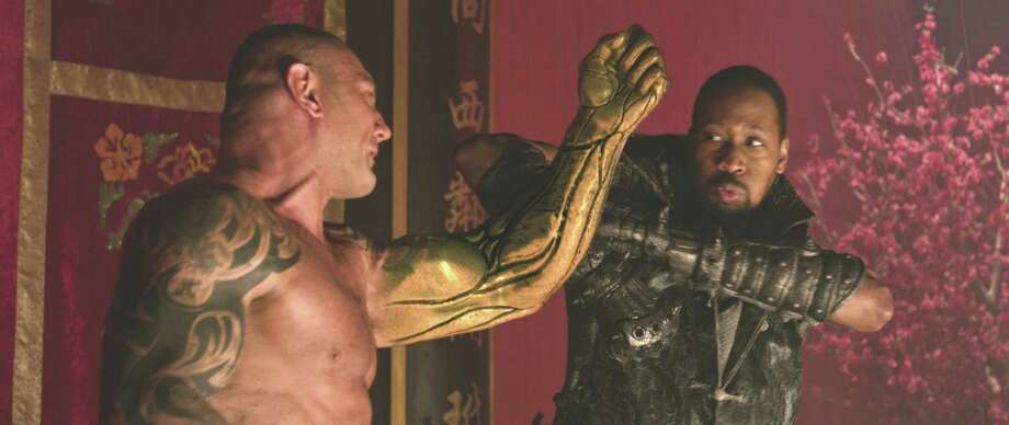 "Universal Studios (L to R) Brass Body (DAVID BAUTISTA) and the Blacksmith (RZA) star in ""The Man With the Iron Fists"", an action-adventure inspired by kung-fu classics as interpreted by Quentin Tarantino's longtime collaborators RZA and Eli Roth."
