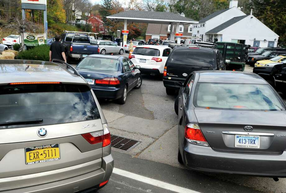 Controlled chaos ensued at the Shell station at Glenville Road and Weaver Street in the Glenvlle section of Greenwich as New Yorkers and Conn. residents descended on the area to fill up tanks and containers on Friday, Nov. 2, 2012. Photo: Cathy Zuraw / Greenwich Time