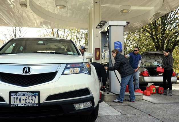 Many New York residents came to the Mobil station on Route 1 in the Cos Cob section of Greenwich to fill up tanks and containers on Friday, Nov. 2, 2012. Traffic jams were common around stations by Interstate-95. Photo: Cathy Zuraw / Greenwich Time