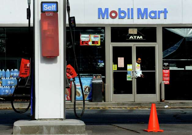 The Mobil Mart station on the Route 1 in the Riverside section of Greenwich, Conn. was out of gas on Friday, Nov. 2, 2012. Controlled chaos ensued at Greenwich gas stations as New York, New Jersey and Conn. residents descend on the area to fill up tanks and containers. Traffic jams were common around stations near Interstate-95. Photo: Cathy Zuraw / Greenwich Time