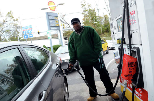 Anthony Davis, of New Rochelle, N.Y., fills up his car at the Shell gas station on West Ave. in Stamford on Friday, Nov. 2, 2012. The gas station closed the entrance on West Ave. to better control the flow of traffic into the station. Cars were forced to enter the station on Grenhart Rd. Controlled chaos ensued at Stamford gas stations as New Yorkers and Conn. residents descend on the area to fill up tanks and containers. A run on Stamford and Greenwich gas stations by fuel-starved New York and New Jersey residents continued Friday, Nov. 2, 2012. Traffic jams were common around some of the more popular stations in downtown Stamford and those open by Interstate-95. Photo: Amy Mortensen / Connecticut Post Freelance
