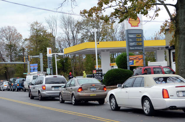 Cars wait in line for gasoline at the Shell gas station on West Ave. in Stamford on Friday, Nov. 2, 2012. The gas station closed the entrance on West Ave. to better control the flow of traffic into the station. Cars were forced to enter the station on Grenhart Rd. Controlled chaos ensued at Stamford gas stations as New Yorkers and Conn. residents descend on the area to fill up tanks and containers. A run on Stamford and Greenwich gas stations by fuel-starved New York and New Jersey residents continued Friday, Nov. 2, 2012. Traffic jams were common around some of the more popular stations in downtown Stamford and those open by Interstate-95. Photo: Amy Mortensen / Connecticut Post Freelance