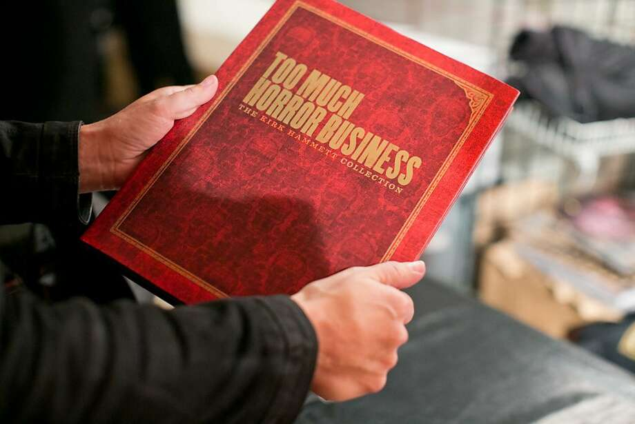 "Blood red makes a good color for the cover of Metallica guitarist Kirk Hammett's new book, ""Horror Business: The Kirk Hammett Collection."" The book, released this fall, contains 300 pictures of items in his vast trove of antique posters, masks, toys and other creepy objects. A book party was held Nov. 1 at Public Works in San Francisco. Photo: Drew Altizer Photography"