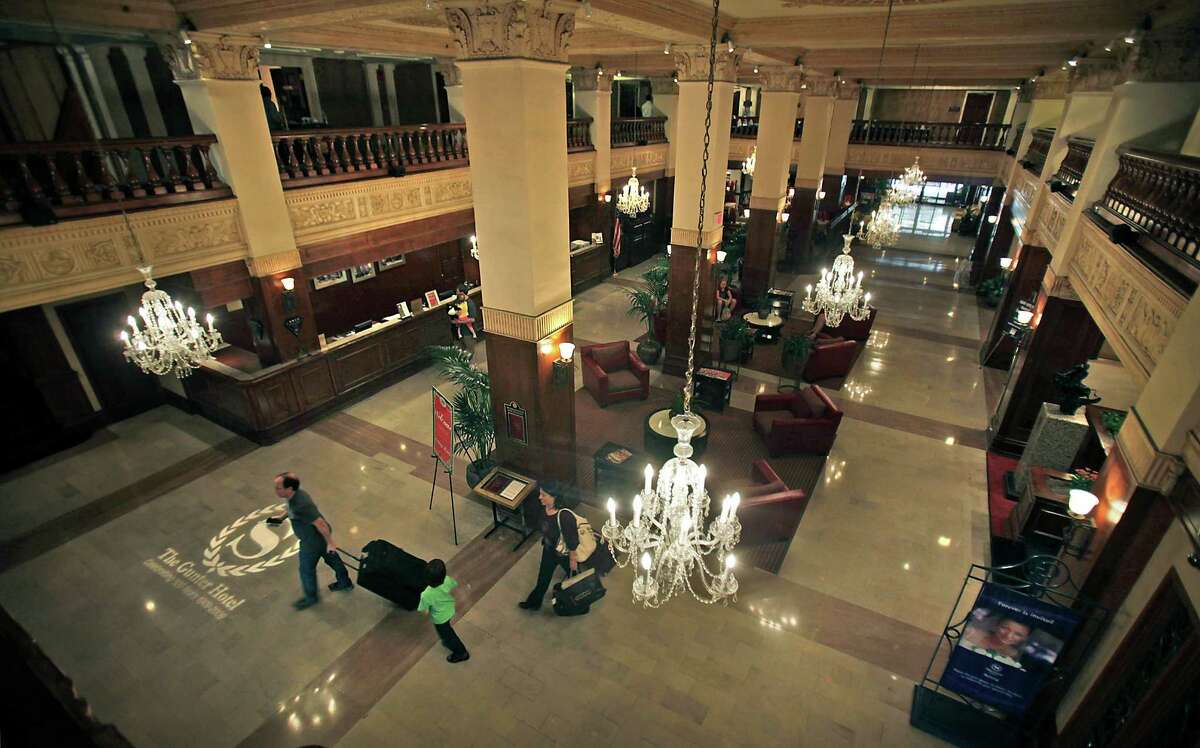 The lobby of the historic Gunter Hotel, seen in 2011, is decorated with massive columns and warm rich wood.