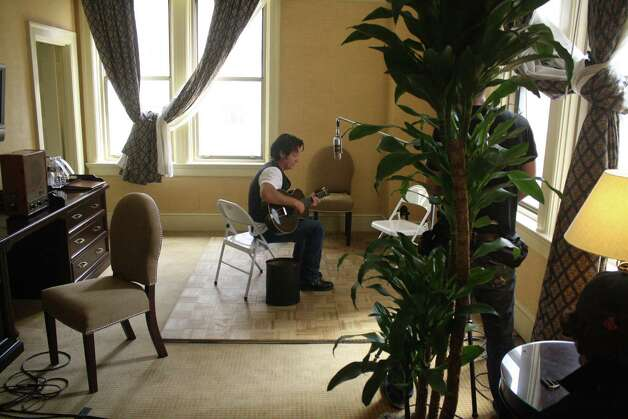 John Mellencamp works on a song for a CD at the Gunter Hotel in San Antonio in 2009. Photo: Jim Beal Jr., San Antonio Express-News / jbeal@express-news.net