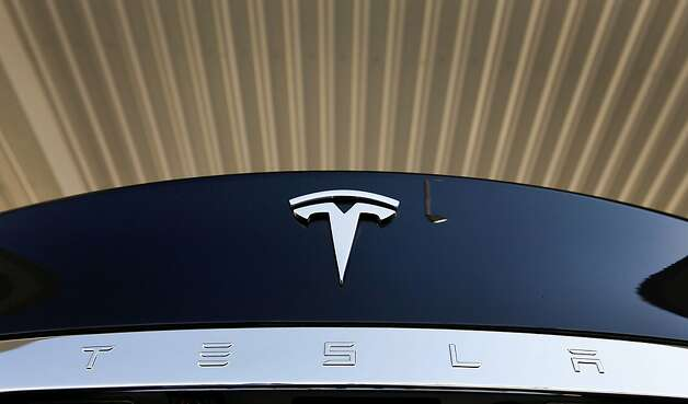Tesla Motors Inc. logo is seen on a Model S sedan after the grand opening of the Tesla Supercharger station in Lebec, California, U.S., on Friday, Oct. 19, 2012. Tesla Motors Inc., the electric-car company led by Elon Musk, built a network of solar-powered rapid-charge stations on major U.S. highways to expand the driving range for owners of its cars at no cost to them. Photographer: Patrick T. Fallon/Bloomberg Photo: Patrick T. Fallon, Bloomberg