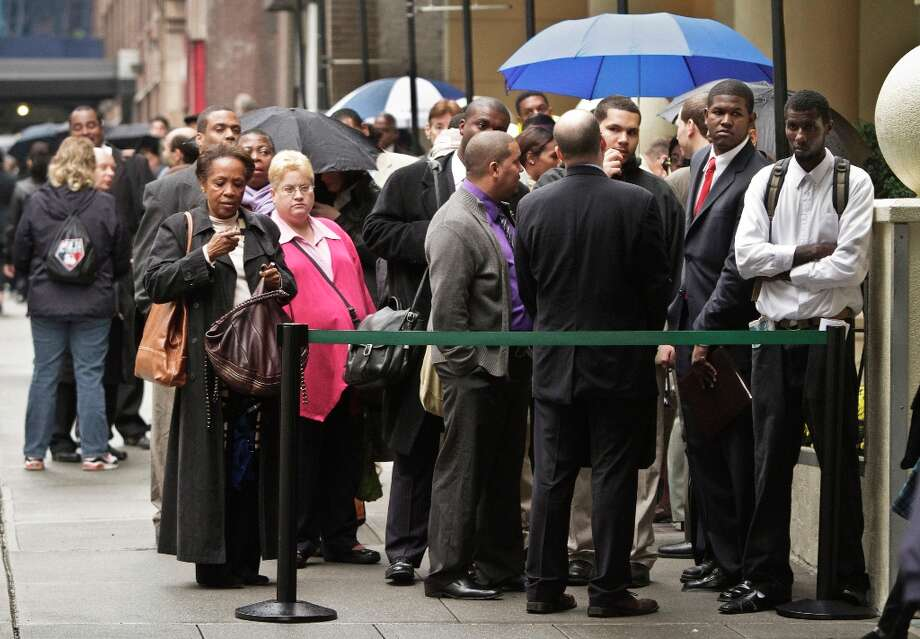 In this Wednesday, Oct. 24, 2012 photo, job seekers wait in line to see employers at the National Career Fairs' job fair in New York. According to government reports released Friday, Nov. 2, 2012, the U.S. economy added 171,000 jobs in October, and the unemployment rate ticked up to 7.9 percent. (AP Photo/Bebeto Matthews) Photo: Bebeto Matthews, Associated Press / AP