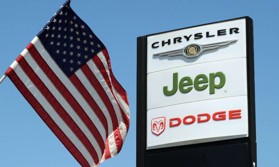 "(FILES)View of a Chrysler Jeep Dodge sign at a Chrysler dealer in Los Angeles on September 3, 2010.  Chrysler's sales accelerated to its best July performance in five years while rival Ford stumbled and Volkswagen roared ahead, automakers said August 1, 2012. Chrysler has now posted sales gains for 28 straight months as July sales rose 13 percent to 126,089 vehicles. ""July was another solid month for Chrysler Group as we again demonstrated our disciplined and methodical approach to growing sales and profits,"" said Reid Bigland, head of US sales.  (Mark Ralston/AFP/GettyImages) Photo: MARK RALSTON, AFP/Getty Images / AFP ImageForum"