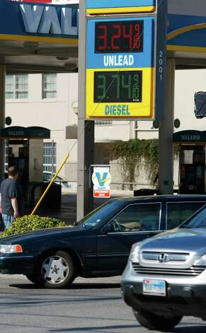 Gas prices are seen Friday, Nov. 2, 2012 as vehicles drive in front of a Valero gas station at Broadway and East Josephine Streets. Photo: William Luther, San Antonio Express-News / © 2012 San Antonio Express-News