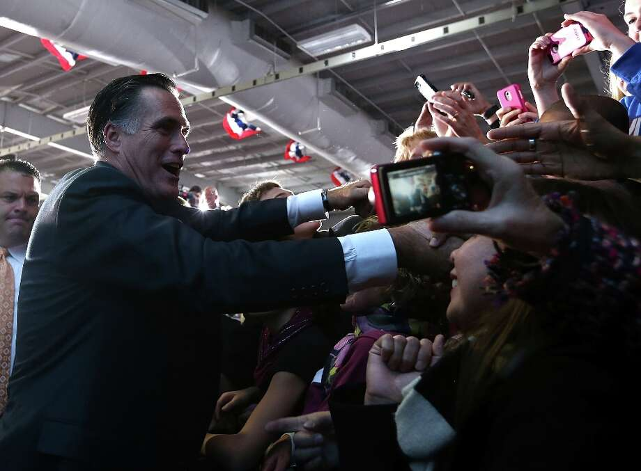 WEST ALLIS, WI - NOV.2:  Republican presidential candidate, former Massachusetts Gov. Mitt Romney  greets supporters during a campaign rally at the Wisconsin Products Pavilion at State Fair Park on November 2, 2012 in West Allis, Wisconsin. With less than one week to go before election day, Mitt Romney is campaigning in Wisconsin and Ohio.  (Justin Sullivan/Getty Images) Photo: Justin Sullivan, Getty Images / 2012 Getty Images