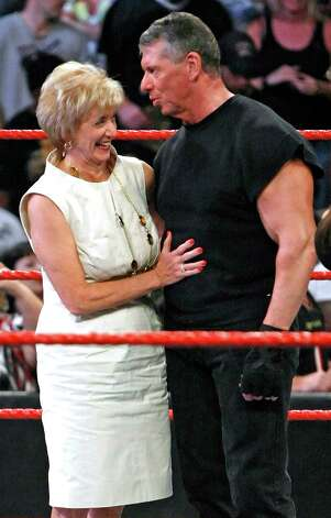 World Wrestling Entertainment Inc. CEO Linda McMahon and her husband, WWE Chairman Vince McMahon, appear in the ring during Vince McMahon's 64th birthday celebration at the WWE Monday Night Raw show at the Thomas & Mack Center August 24, 2009 in Las Vegas, Nevada. Photo: Ethan Miller, 2009 Getty Images / 2009 Getty Images