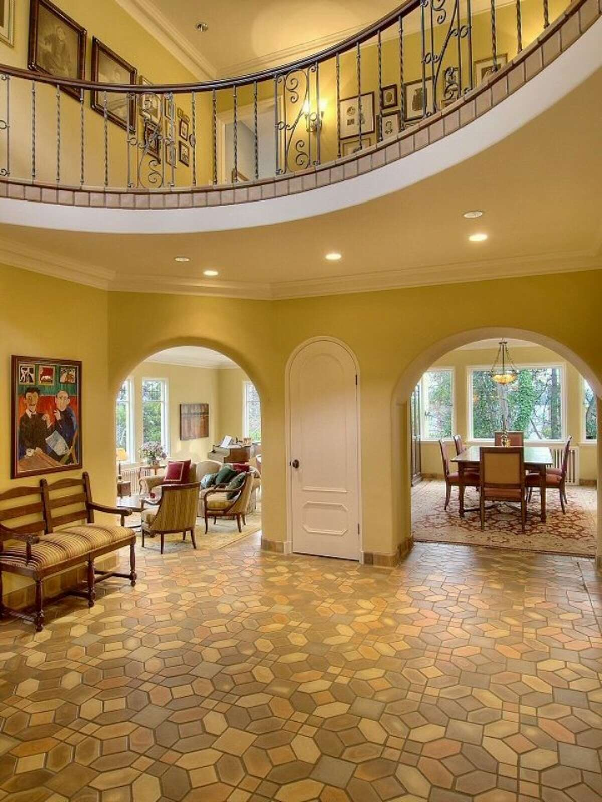 Foyer of 180 Lake Washington Boulevard E.. The 5,490-square-foot house, built in 1928, has four bedrooms, 4.25 bathrooms, arched doorways, a library with a fireplace, a media room, a sun room, a patio and a two-car garage on a 12,975-square-foot lot. It's listed for $3.799 million.