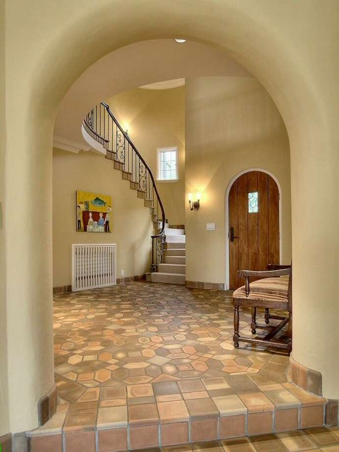Foyer of 180 Lake Washington Boulevard E.. The 5,490-square-foot house, built in 1928, has four bedrooms, 4.25 bathrooms, arched doorways, a library with a fireplace, a media room, a sun room, a patio and a two-car garage on a 12,975-square-foot lot. It's listed for $3.799 million. Photo: Kathryn Hinds And Margie Zech/Windermere Real Estate